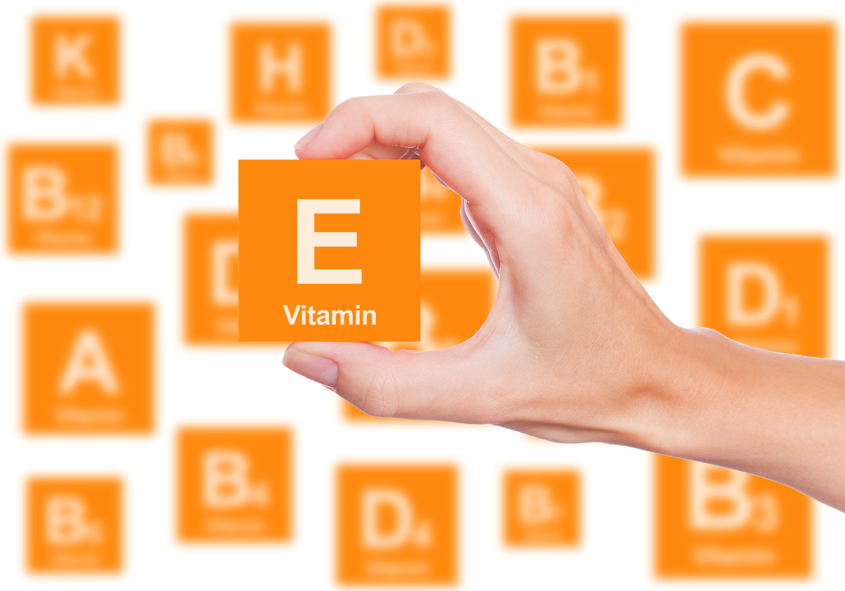 Hand holds a box of vitamin E
