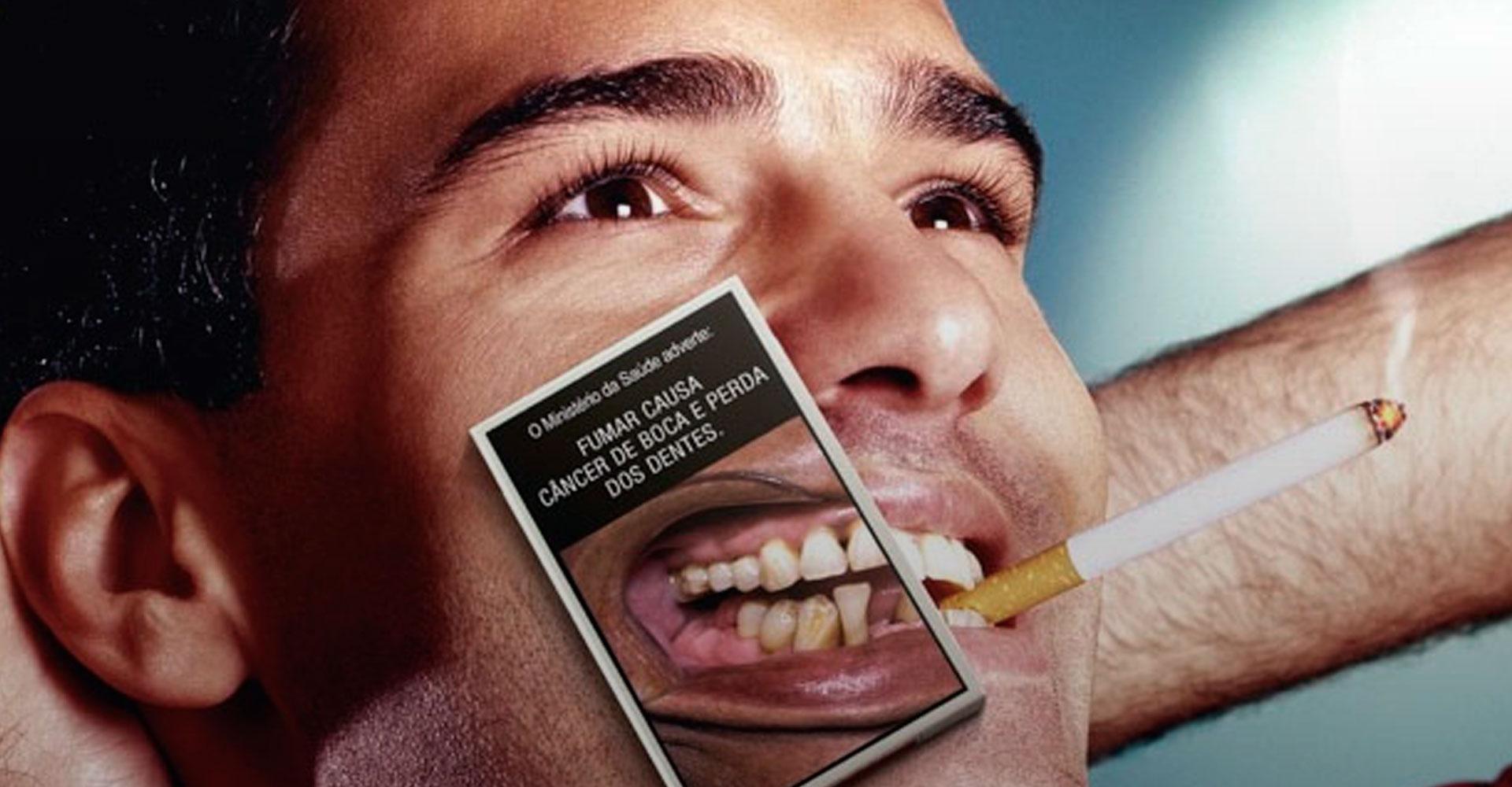 cigarro e dentes amarelados