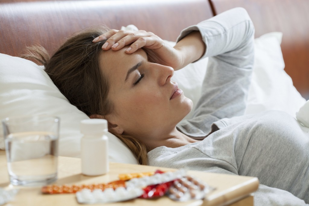 Horizontal view of woman suffering from flu
